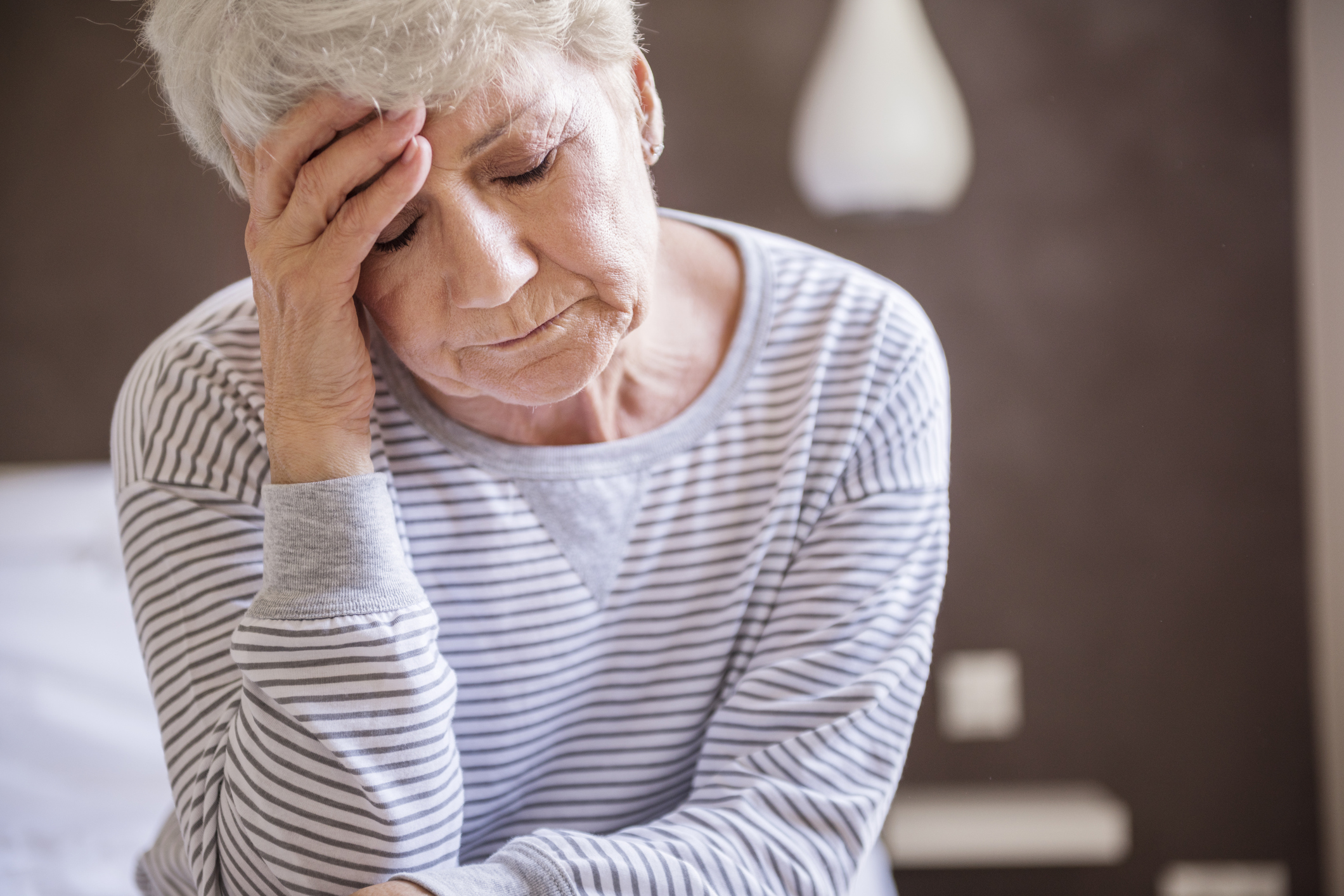 Seasonal depression in seniors can be difficult to manage. Here a senior woman feels blue.