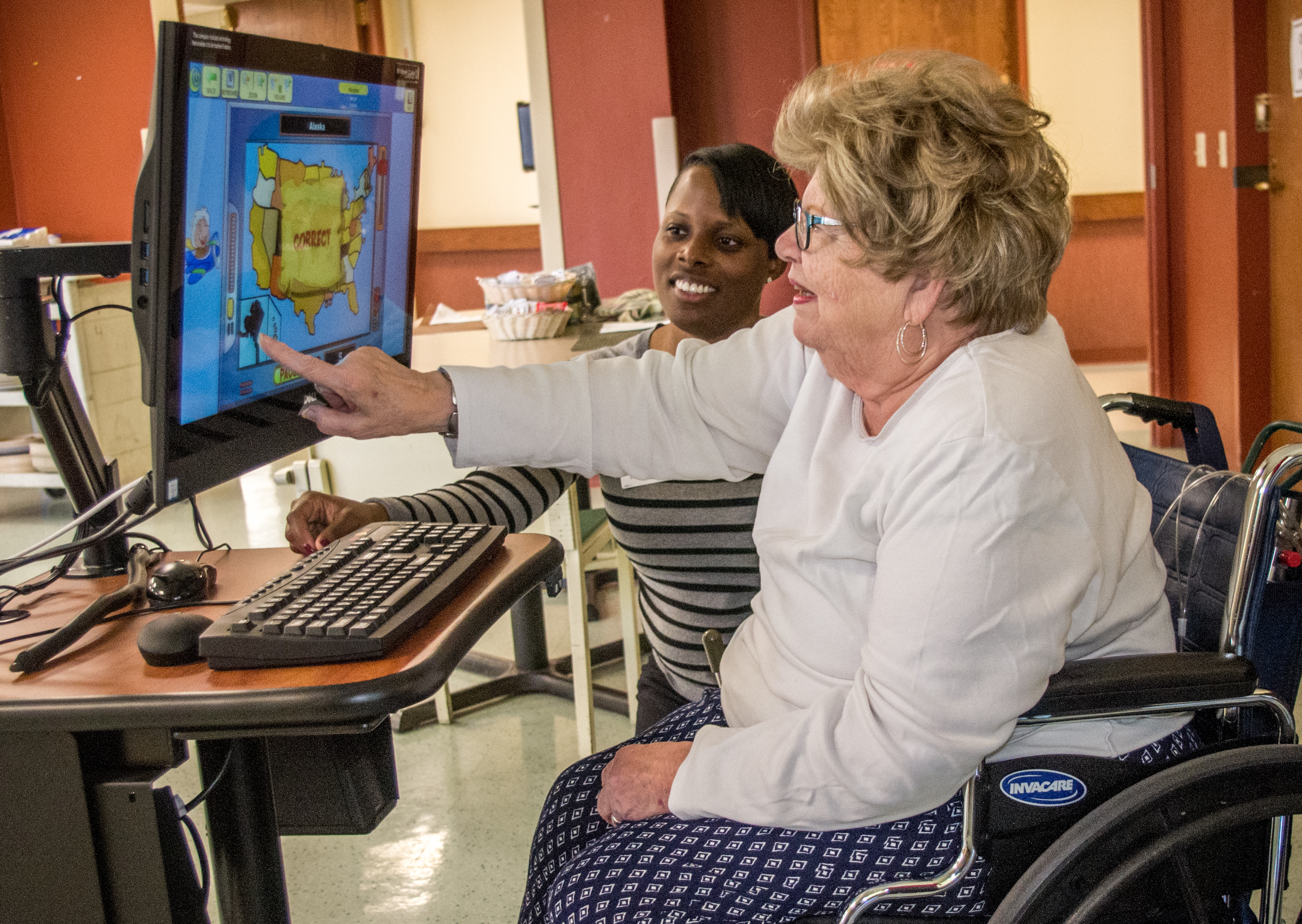 Bethesda resident Patricia Stirlen using the iN2L computer system for seniors at Bethesda Meadow.