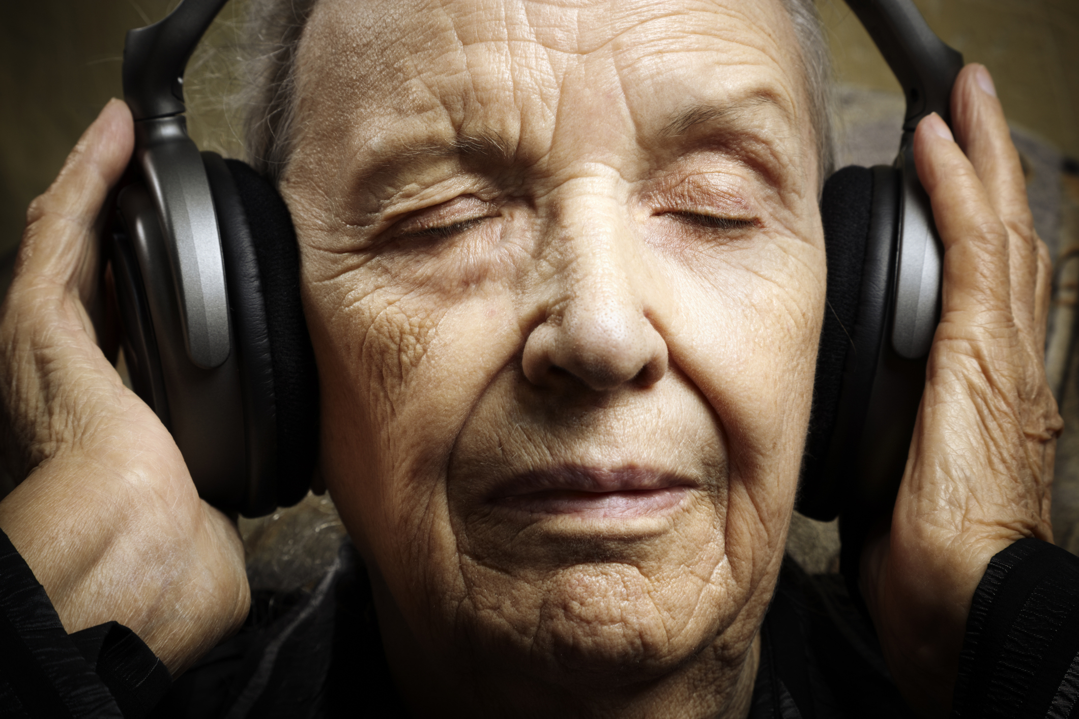 Bethesda music therapy for seniors can range from listening to music, like the senior in this photo, or playing music! The benefits of music therapy for seniors include improved memory and reduced stress.