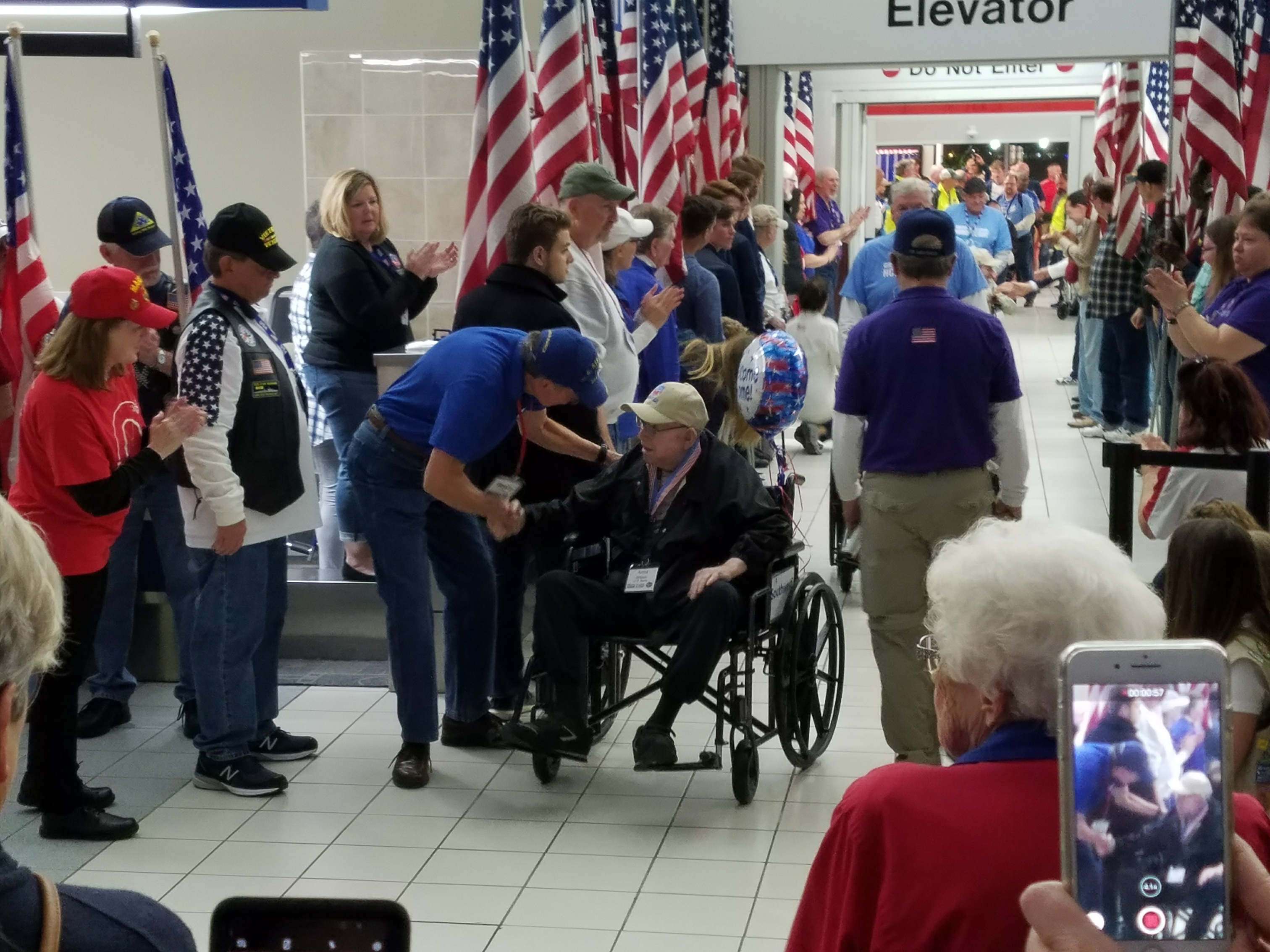 "Amos Wilson, Bethesda Hospice Care patient and resident at Bethesda Dilworth, as he was honored at the Greater St. Louis Honor Flight's ""Welcome Home"" ceremony for Veterans."