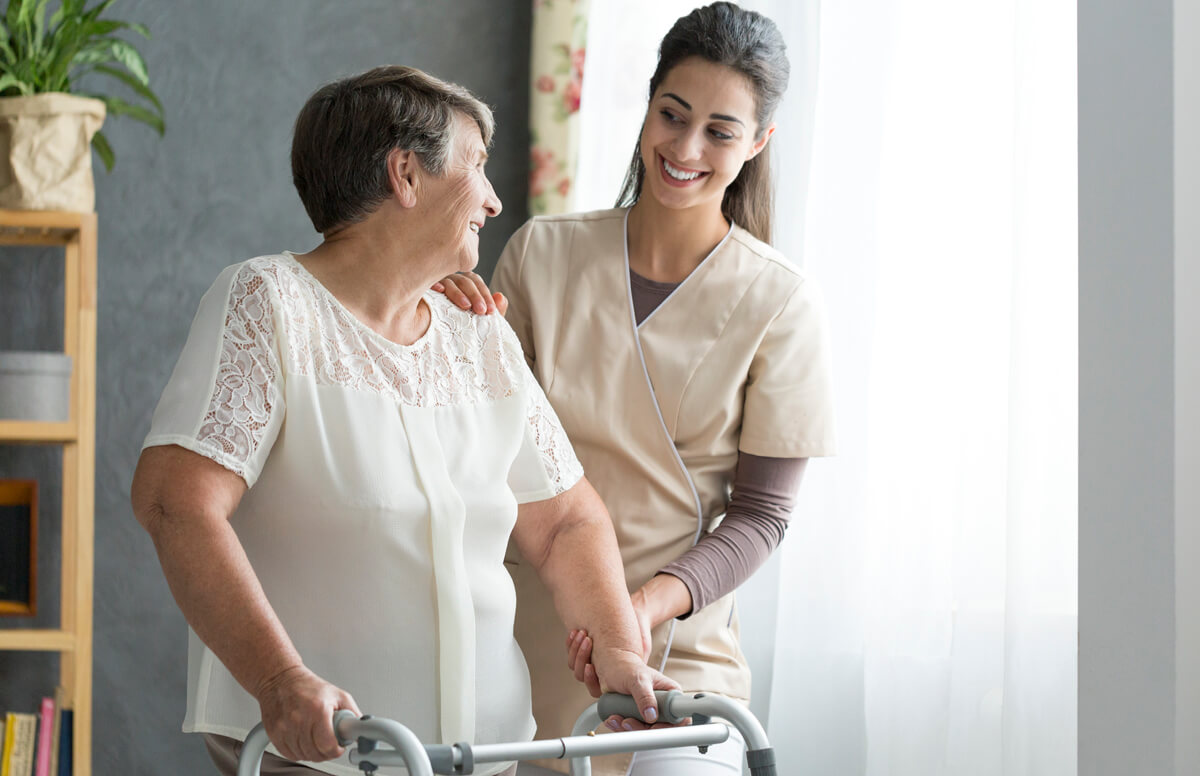 Planning ahead for assisted living or other long-term care options allows seniors, like this woman, to find the care that they need without feeling rushed. Here, a nurse chats with a senior woman at an Assisted Living community.