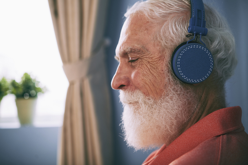 A man listens to music to manage sundown syndrome