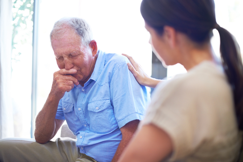 A woman looking for signs that her senior parent needs extra care