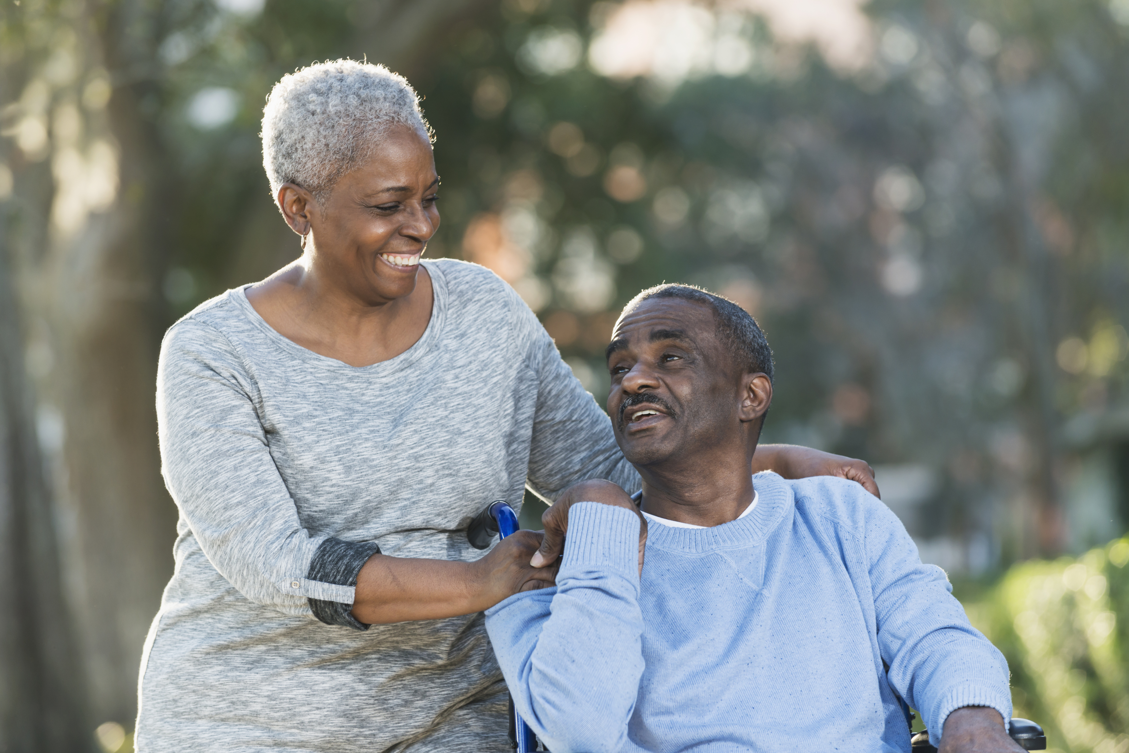 Senior caregiving is no easy task. Here, a senior woman cares for her senior husband.