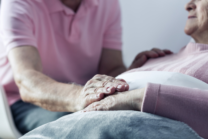 A man communicating with a hospice patient