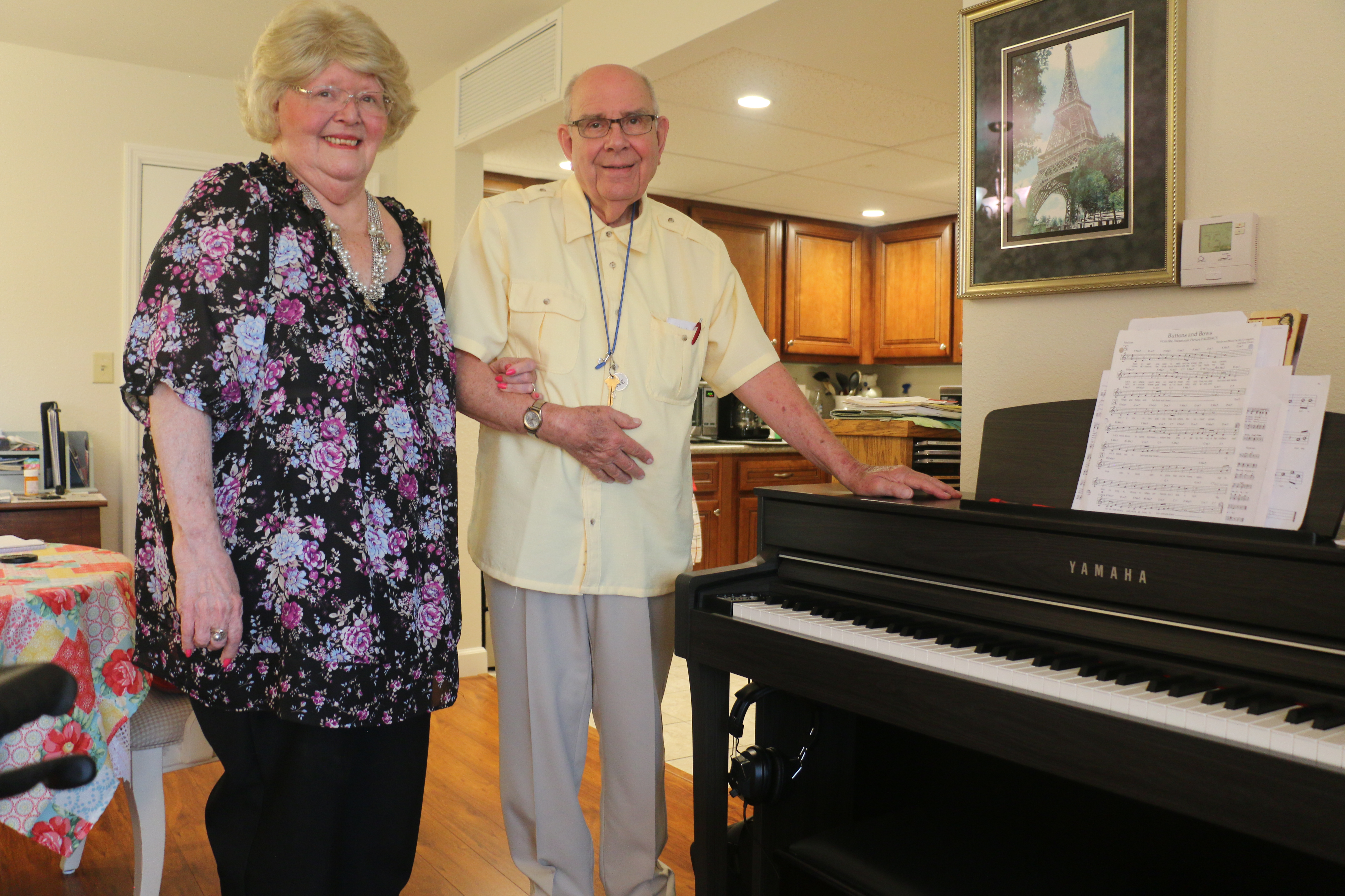 Jim and Judy Thielker, next to their piano in their apartment at Bethesda Terrace, an independent living community in St. Louis.