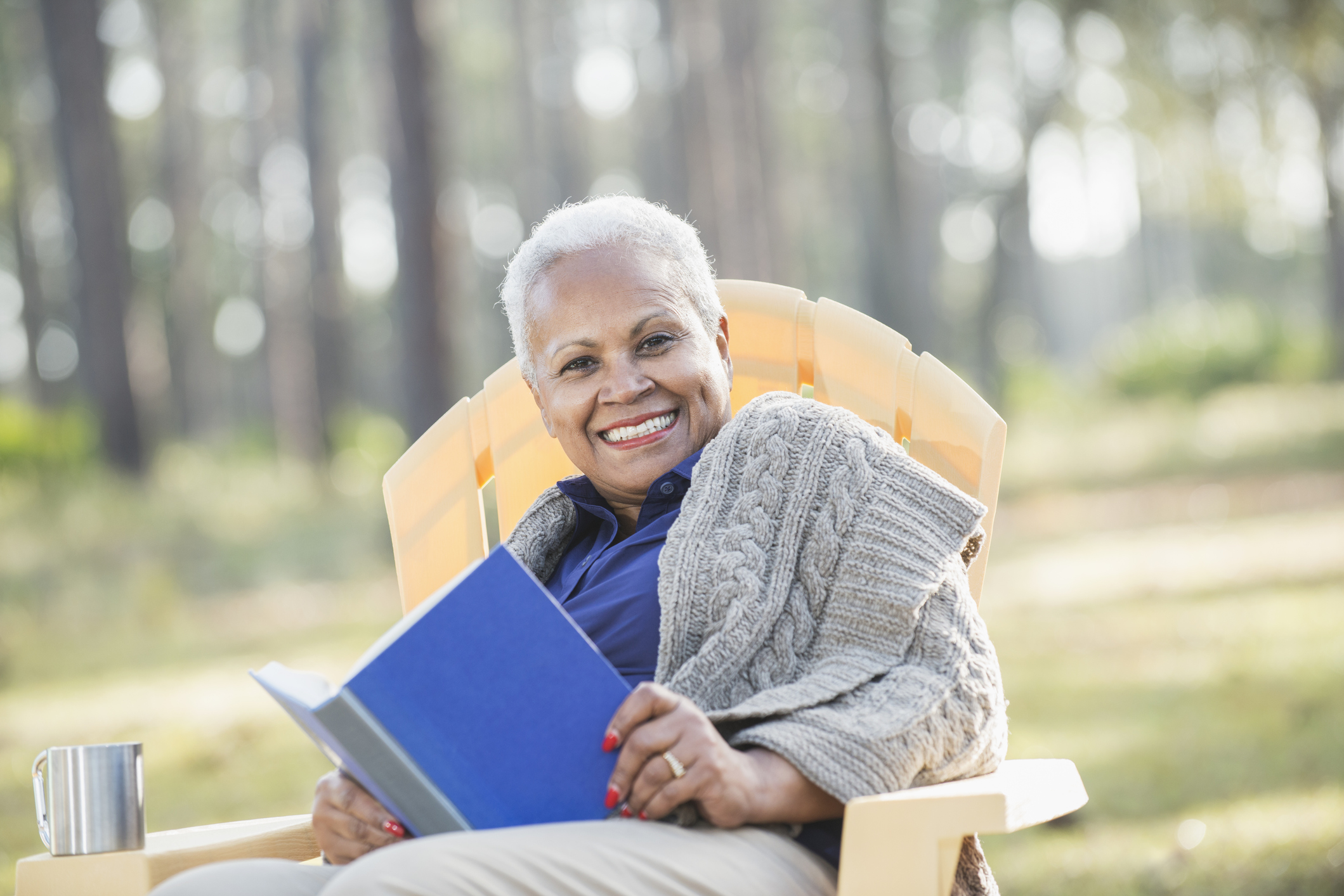 Women relaxes and celebrates her move to an assisted living community in autumn.
