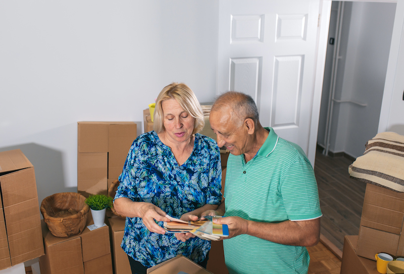 A senior couple moves into their new independent living community.
