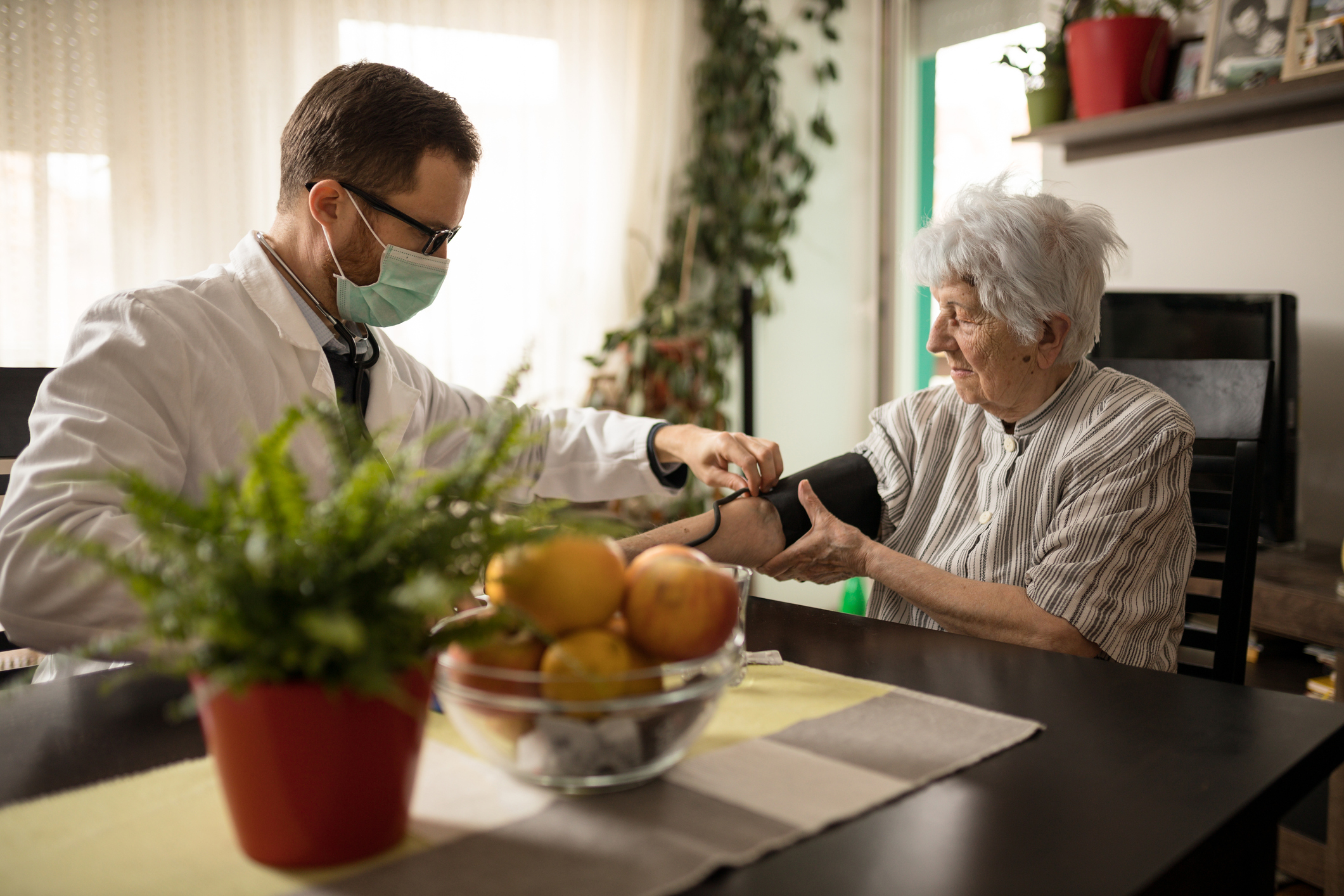 Home care professional caring for senior adult