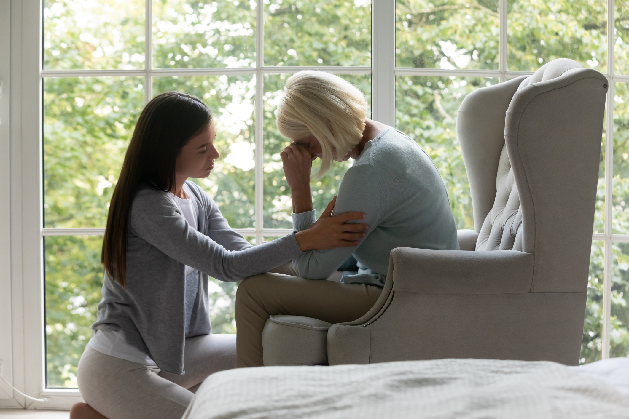 Daughter providing grief support to elderly mom