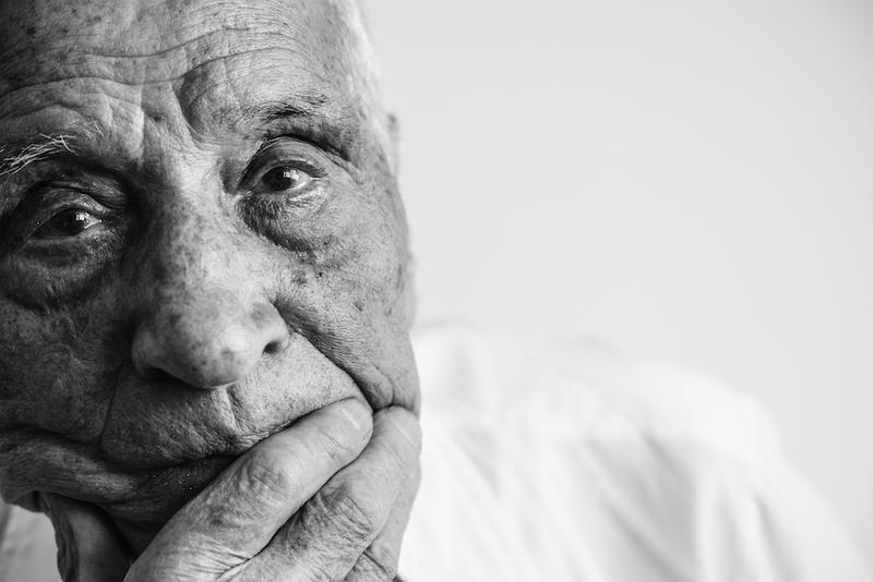 A senior man ponders mental health and aging.