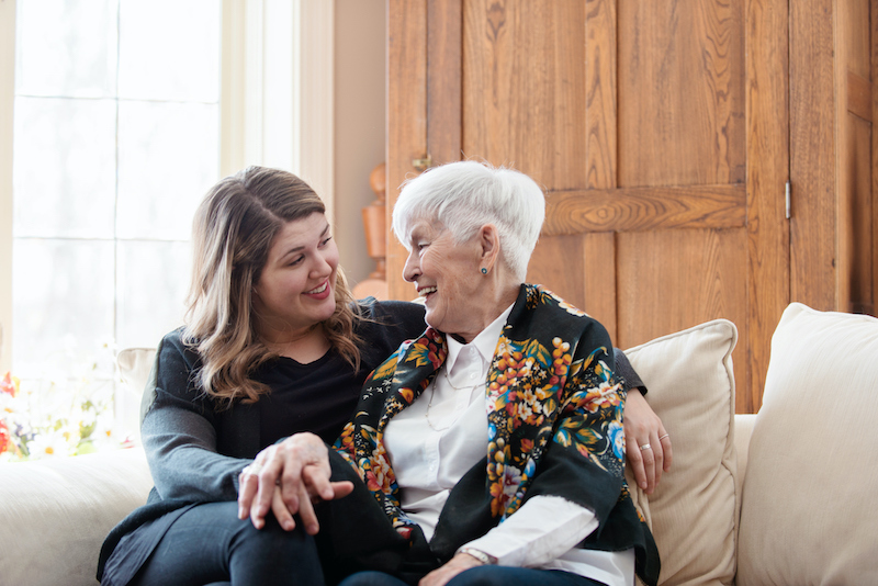 A woman talks to her senior mother about the benefits of assisted living